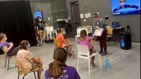 Group of kids learning to write a play