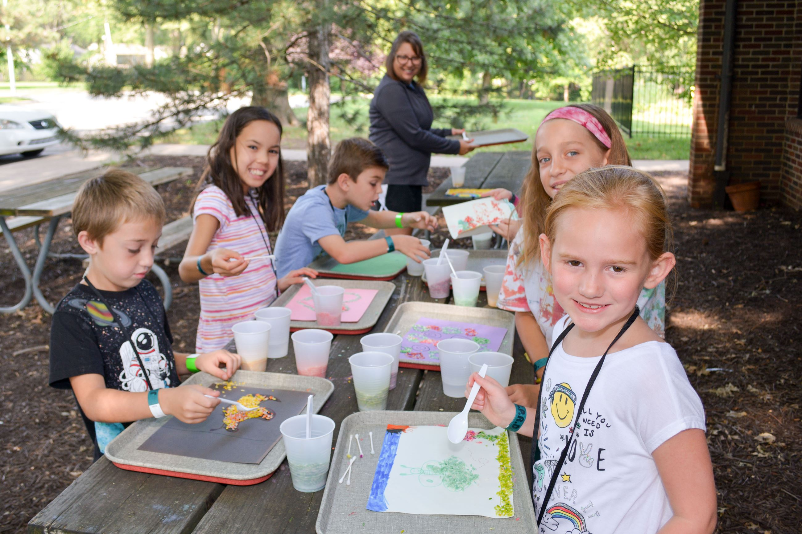 Kids completing summer camp art project