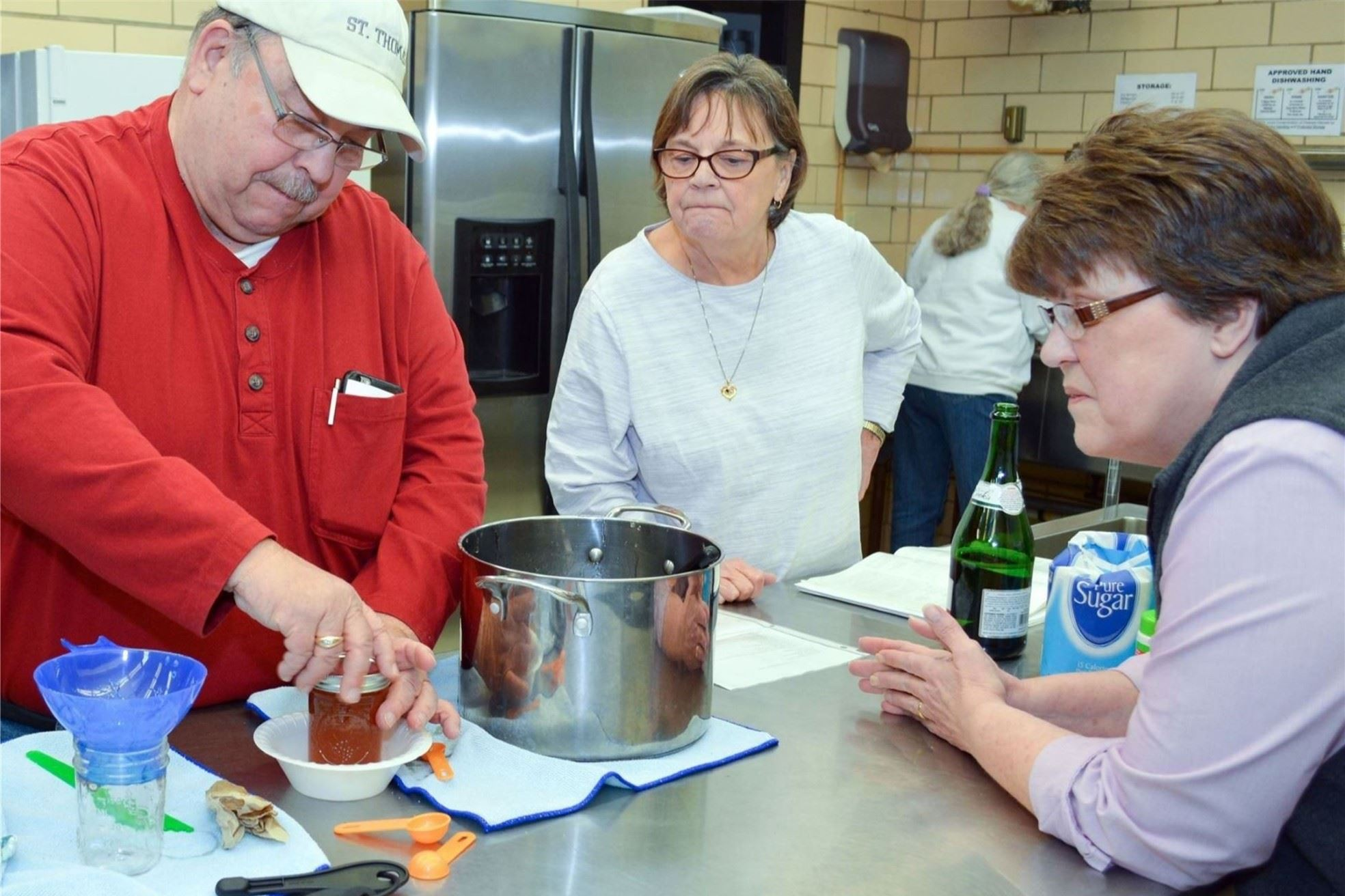 Adults participate in cooking program