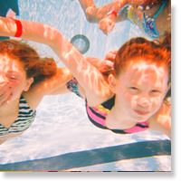 Kids swimming under water