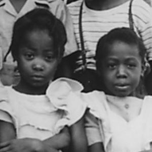 Portrait of two young African American girls, students at Walker School